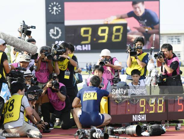 Photographers jostle to snap pictures of Yoshihide Kiryu on Sept 9 the day he won the men's 100 meters final at an intercollegiate meet in Fukui...