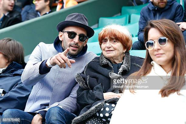 Photographers JR and Agnes Varda attend Day Twelve of the 2016 French Tennis Open at Roland Garros on June 2 2016 in Paris France
