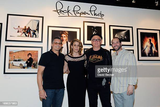 Photographers Kevin Mazur Denise Truscello Robert Knight and CEO of Rock Paper Photo Mark Halpen appear at the grand opening of the Rock Paper Photo...