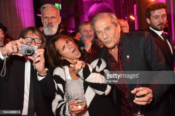 Photographers Kuh Kanh Jean Marie Marion Florence and Alain Benoist attend the Avon Life Colour Party by Kenzo Fragrance Launch as part of the Paris...