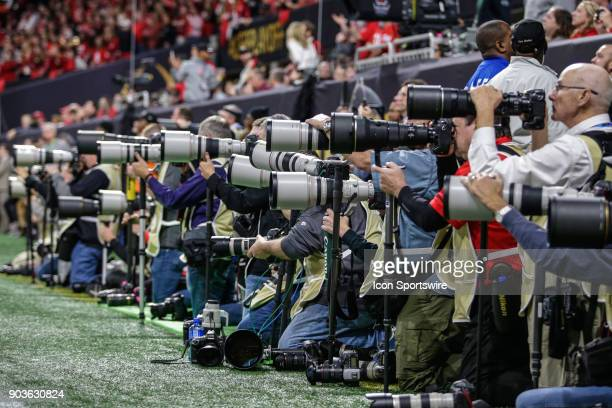 Photographers line the sidelines during the College Football Playoff National Championship Game between the Alabama Crimson Tide and the Georgia...