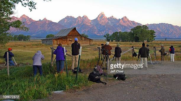 Photographers line up in early morning to shoot one of the most photographed barns in America - the southern Moulton barn in Grand Teton National Park