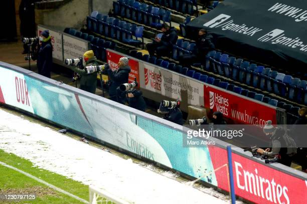 Photographers look on during the Emirates FA Cup Fourth Round match between Wycombe Wanderers and Tottenham Hotspur at Adams Park on January 25, 2021...