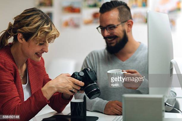 Photographers Looking Images on thier Digital Camera.