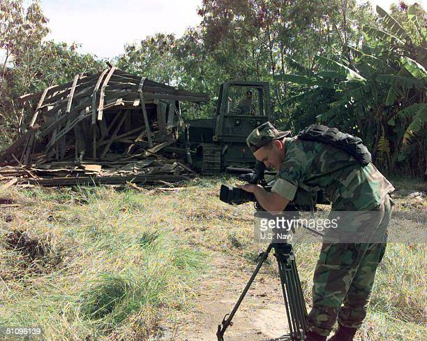 Photographer's Mate 1St Class Andrew Mckaskle Assigned To Fleet Combat Camera Atlantic Documents Naval Mobile Construction Battalion Seven...
