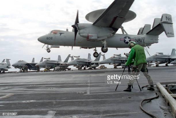 Photographers Mate 3Rd Class Dan Bassett Shoots Video Of An E2-C Hawkeye Landing On The Flight Deck Of The USS Carl Vinson At Arabian Gulf, February...