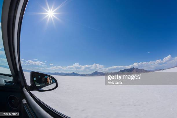 Photographer's mirror selfie as car races across Bonneville Salt Flats, Utah.