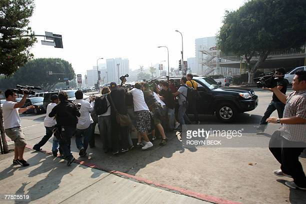 Photographers mob Britney Spears' car as she arrives at Family Court for a hearing to work out custody arrangements with her ex-husband Kevin...