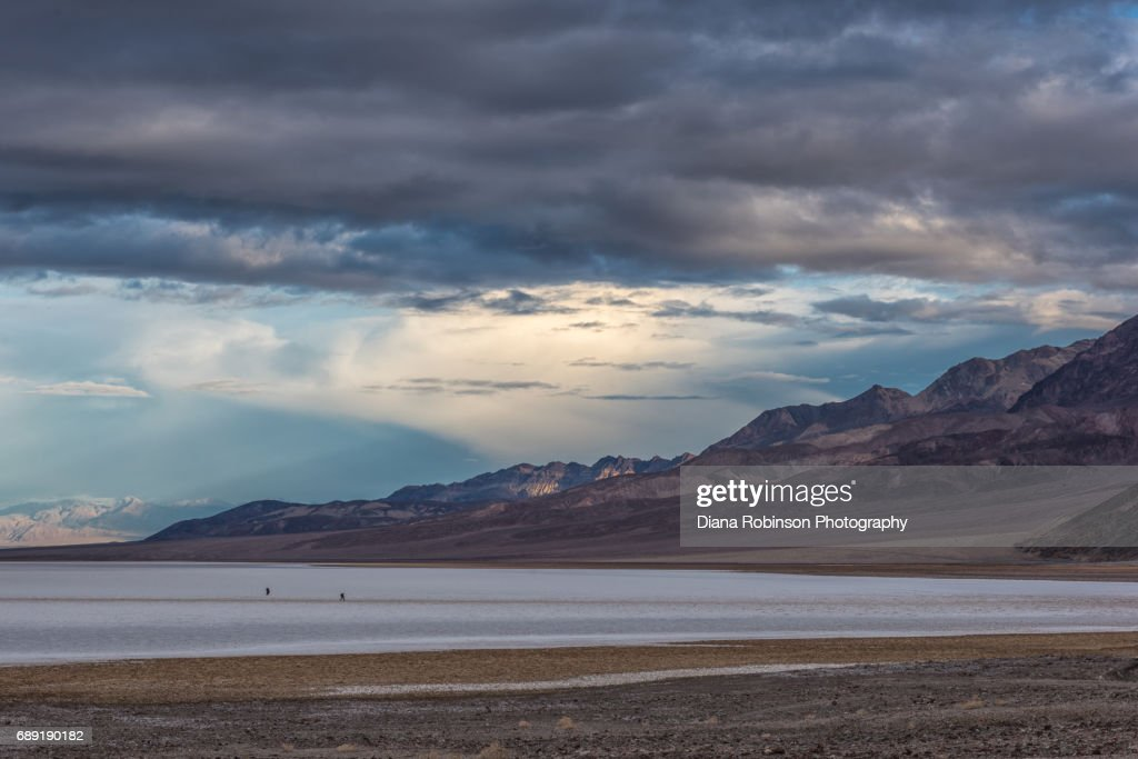 Photographers on Badwater Basin at sunrise, Death Valley National Park, California : Stock Photo