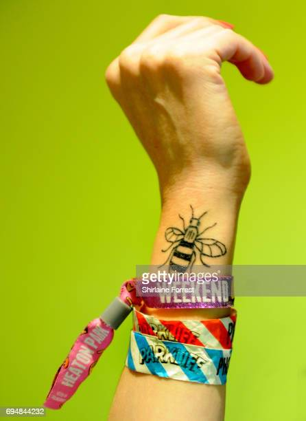 Photographer's own Love Manchester bee tattoo by artist Cathy Santos with wristband accreditation to Parklife Festival 2017 at Heaton Park on June 11...