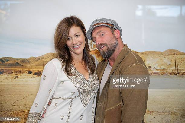 Photographers Pamela Litcky and Brian Bowen Smith attend the 'Desert Voices' opening exhibition at De Re Gallery on July 16 2015 in West Hollywood...