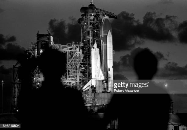 Photographers photograph the Space Shuttle Challenger on its launch pad at Kennedy Space Center in Florida prior to the orbitor's earlymorning launch...