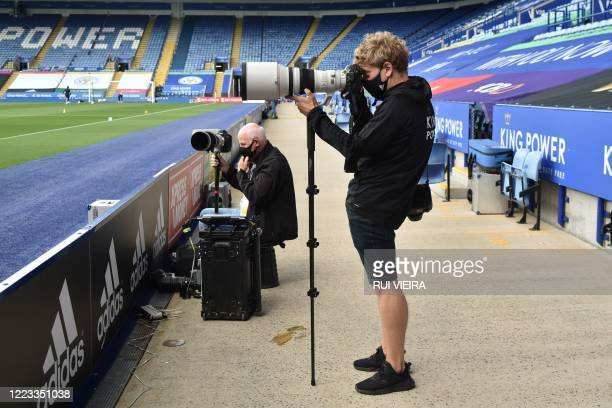 Photographers prepare ahead of the English FA Cup quarter-final football match between Leicester City and Chelsea at King Power Stadium in Leicester,...