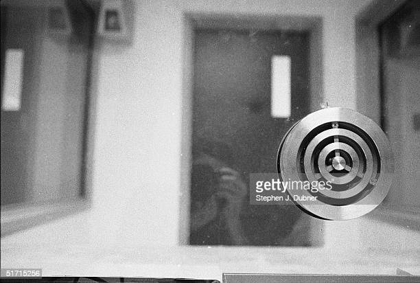 **EXCLUSIVE** A photographer's reflection in a twoway mirror of a visiting room in the Federal ADX Supermax prison in Florence Colorado August 30...