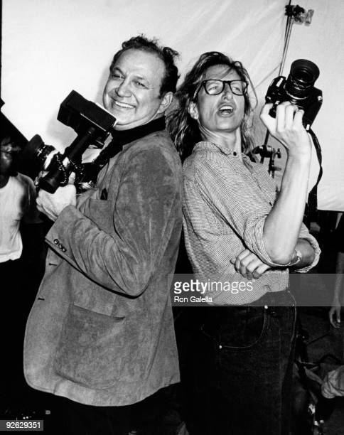Photographers Ron Galella and Annie Leibovitz attend Vanity Fair Magazine Photo Shoot on September 22 1989 at the Newark Airport in Newark New Jersey