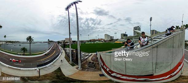 Photographers shoot from an elevated location during the Firestone Grand Prix IndyCar race on March 13 2016 in St Petersburg Florida