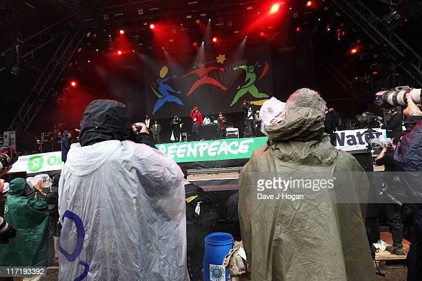 Photographers shoot The Wu-Tang Clan at the Glastonbury Festival at Worthy Farm, Pilton on June 24, 2011 in Glastonbury, England. The festival, which...