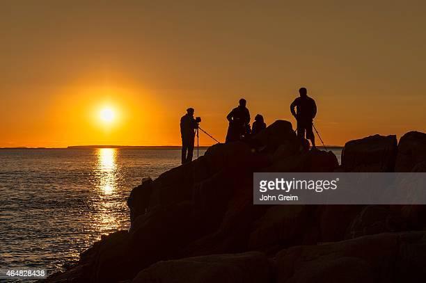Photographers shooting a coastal sunset