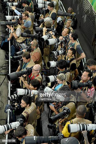 Photographers sit ready prior to the start of the athletics on Day 9 of the Rio 2016 Olympic Games at the Olympic Stadium on August 14, 2016 in Rio...