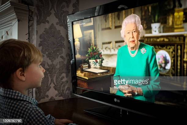 Photographer's son watches from home as Queen Elizabeth II addresses the nation in a special broadcast to the United Kingdom and the Commonwealth in...