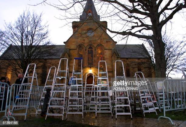 Photographers step ladders are left outside Dornoch Cathedral Scotland to reserve their positions in preparation of Madonna and Guy Ritchie's...