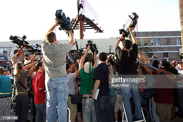 Photographers surround actress Elizabeth Taylor as she leaves the CNN building after appearing on 'Larry King Live' on May 30 2006 in Los Angeles...