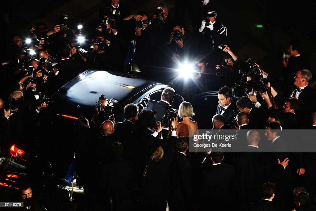 Photographers surround the car as Johnny Hallyday departs the Vengeance Premiere at the Palais Des Festivals during the 62nd International Cannes Film Festival on May 17, 2009 in Cannes, France.