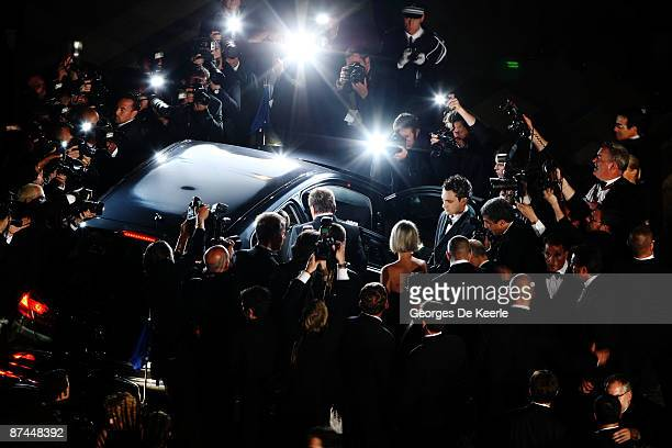 Photographers surround the car as Johnny Hallyday departs the Vengeance Premiere at the Palais Des Festivals during the 62nd International Cannes...