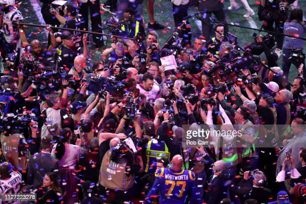 Photographers surround Tom Brady of the New England Patriots after his 133 win over the Los Angeles Rams in Super Bowl LIII at MercedesBenz Stadium...