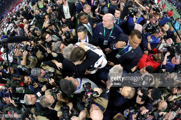 Photographers surround Tom Brady of the New England Patriots celebrates after his teams 133 win over the Los Angeles Rams in Super Bowl LIII at...