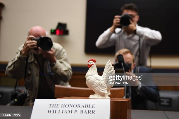 Photographers take a picture of a chicken placed on the empty seat for US Attorney General Bill Barr in the House Judiciary Committee room on Capitol...