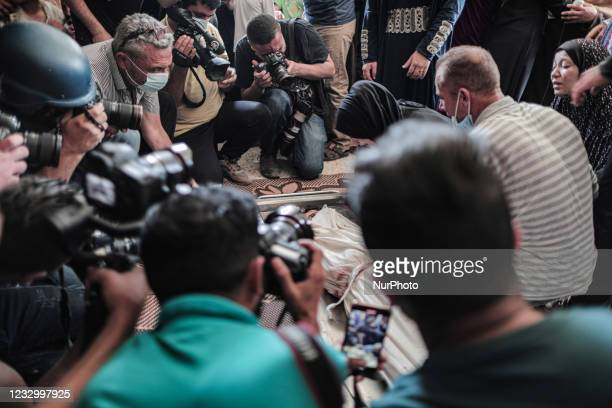 Image contains graphic content.) Photographers take a picture of relatives of Palestinian Diama Assaliya mourning during her funeral after an Israeli...