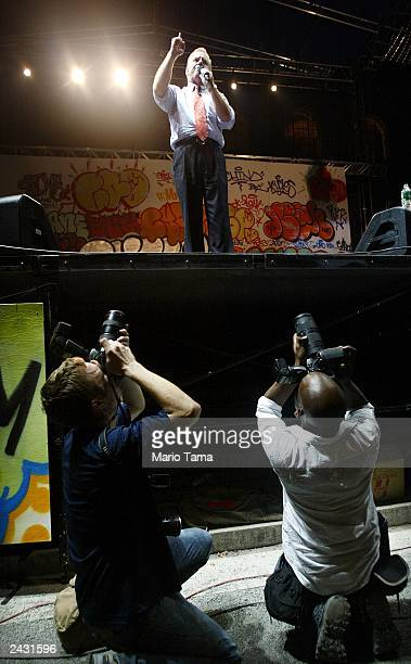 Photographers take aim as Democratic presidential candidate Howard Dean gives a speech in Bryant Park on the last stop of his Sleepless Summer Tour...