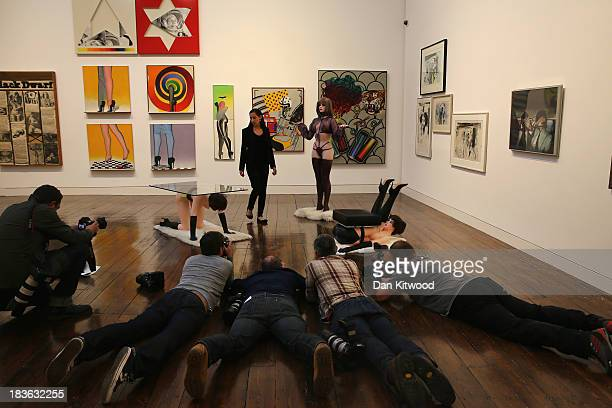 Photographers take photographs of a Christie's employee during the 'When Britain went Pop' photocall at Christie's auction house on October 8 2013 in...