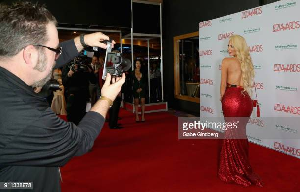 Photographers take photos of adult film actress Nicolette Shea during the 2018 Adult Video News Awards at the Hard Rock Hotel Casino on January 27...