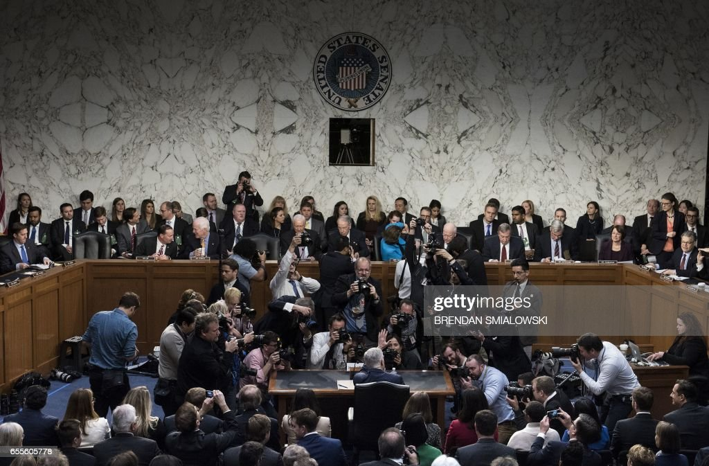 TOPSHOT - Photographers take photos of Neil Gorsuch before the Senate Judiciary Committee confirmation hearing as US President Donald Trump's nominee for the Supreme Court on Capitol Hill in Washington,DC on March 20, 2017. / AFP PHOTO / POOL / Brendan Smialowski