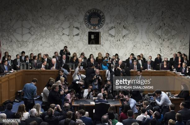 TOPSHOT Photographers take photos of Neil Gorsuch before the Senate Judiciary Committee confirmation hearing as US President Donald Trump's nominee...
