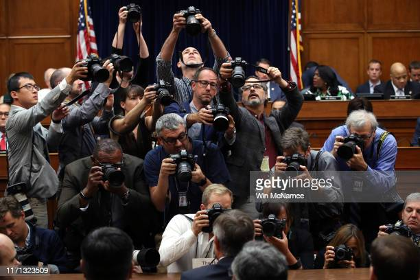 Photographers take pictures as Acting Director of National Intelligence Joseph Maguire prepares to testify before the House Select Committee On...