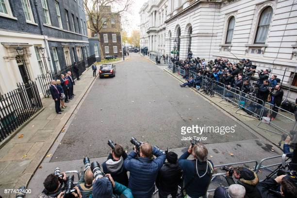 Photographers take pictures as Britain's Chancellor of the Exchequer Philip Hammond holds the red case as he departs 11 Downing Street to deliver his...
