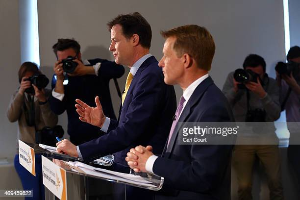 Photographers take pictures as Liberal Democrat leader Nick Clegg and Chair of the Liberal Democrat Manifesto Group David Laws outlined their party's...