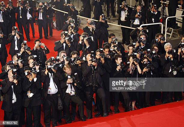 Photographers take pictures before the screening of Vincere in competition at the 62nd Cannes Film Festival on May 19 2009 AFP PHOTO / FRANCOIS...