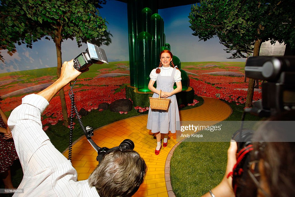 Photographers take pictures of a waxwork Judy Garland as Dorothy inside 'The Wizard of Oz' 4-D experience at Madame Tussauds on July 13, 2010 in New York City.