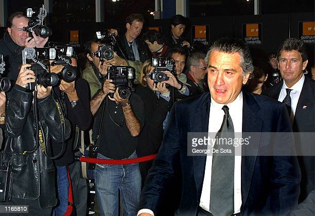 Photographers take pictures of actor Robert De Niro as he attends the Independent Feature Project's Gotham Awards October 1 2001 at Pier Sixty at the...