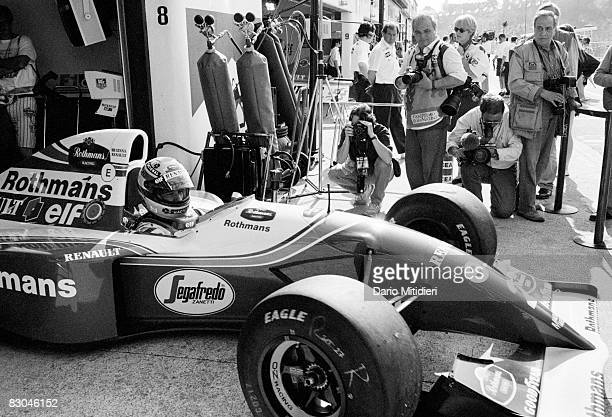 Photographers take pictures of Brazilian race car driver Ayrton Senna as he drives onto the track during a qualifying session for the San Marino F1...