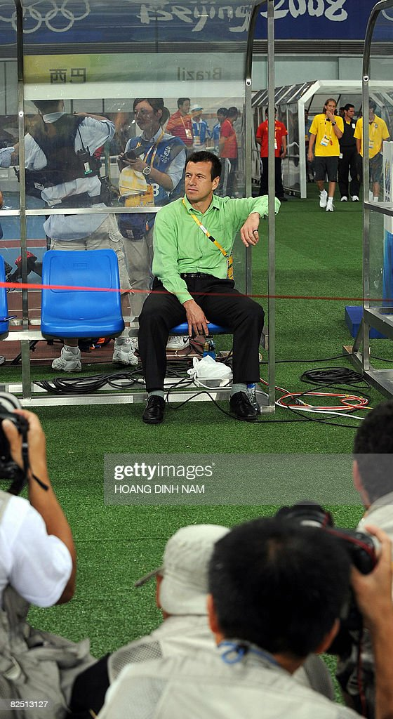 Photographers take pictures of Brazil's head football coach Dunga prior to the 2008 Beijing Olympic Games men's football bronze medal match Brazil vs Belgium in Shanghai on August 22, 2008. Brazil defeated Belgium 3-0. AFP PHOTO/HOANG DINH Nam