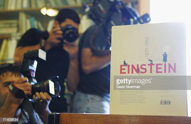 Photographers take pictures of letters and images made public by the Albert Einstein Archives at the Hebrew University July 10 2006 in Jerusalem The...