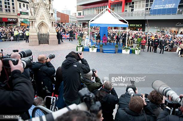 Photographers take pictures of Queen Elizabeth II Catherine Duchess Of Cambridge and Prince Philip Duke of Edinburgh on a visit to Leicester on March...