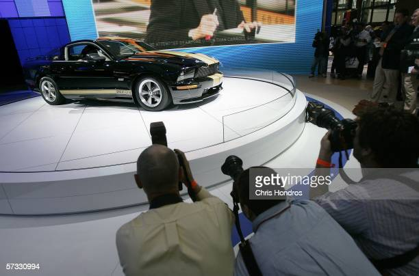 Photographers take pictures of the 2007 Ford Shelby Mustang GTH during the press preview of the 2006 New York International Auto Show April 12 2006...