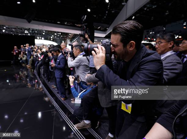 Photographers take pictures of the new Infiniti Q Inspiration concept vehicle as it makes its debut at the 2018 North American International Auto...