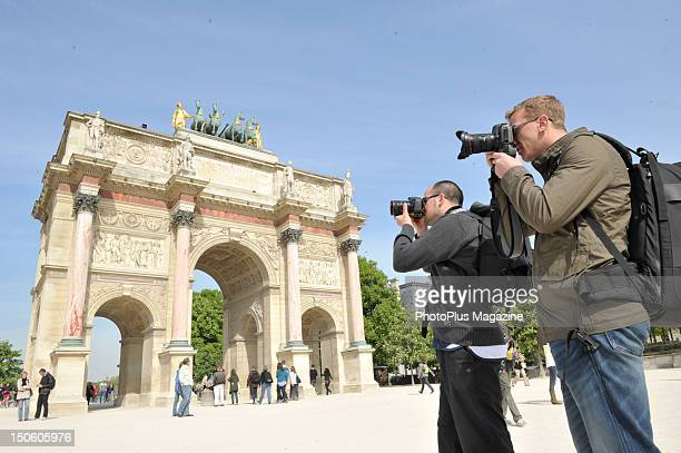 Photographers take pictures of the The Arc de Triomphe du Carousel in Paris April 15 2011